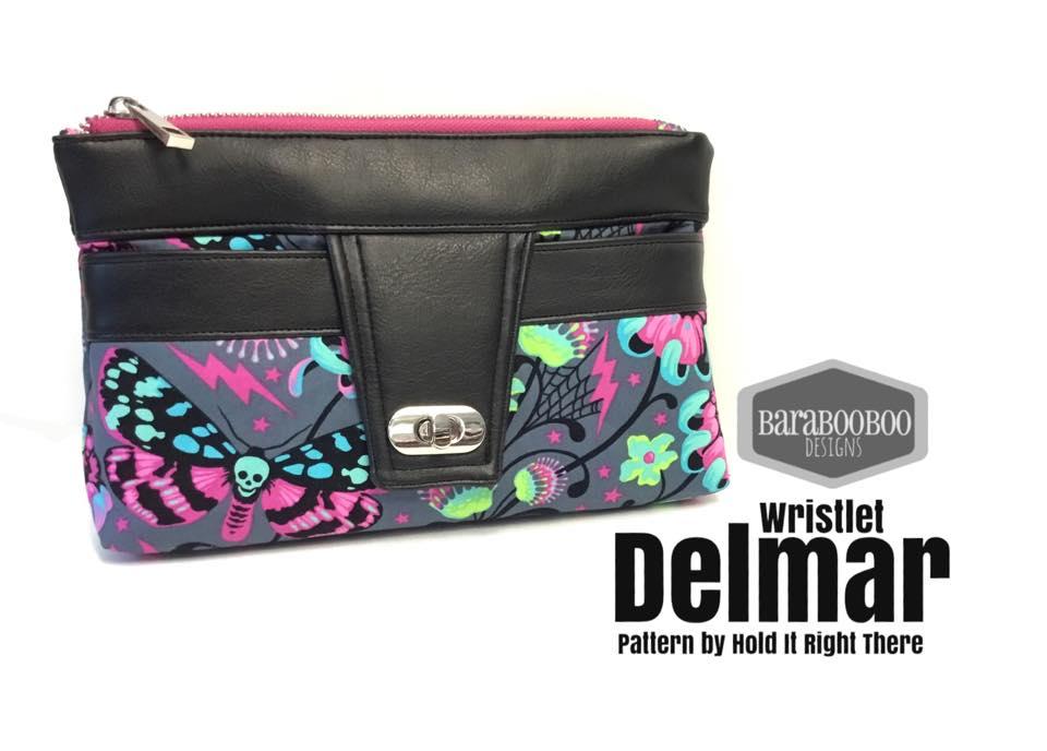 delmar wristlet pattern black trim with grey and neon pattern