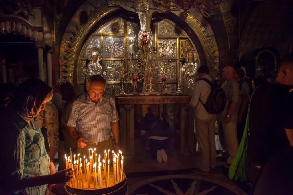 pilgrims lighthing candles at Golgotha at the Church of the Holy Sepulchre in Jerusalem