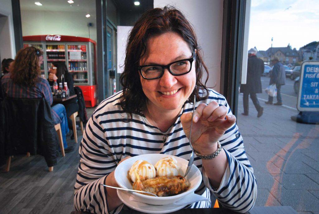 Anja eating a deep fried Mars Bar