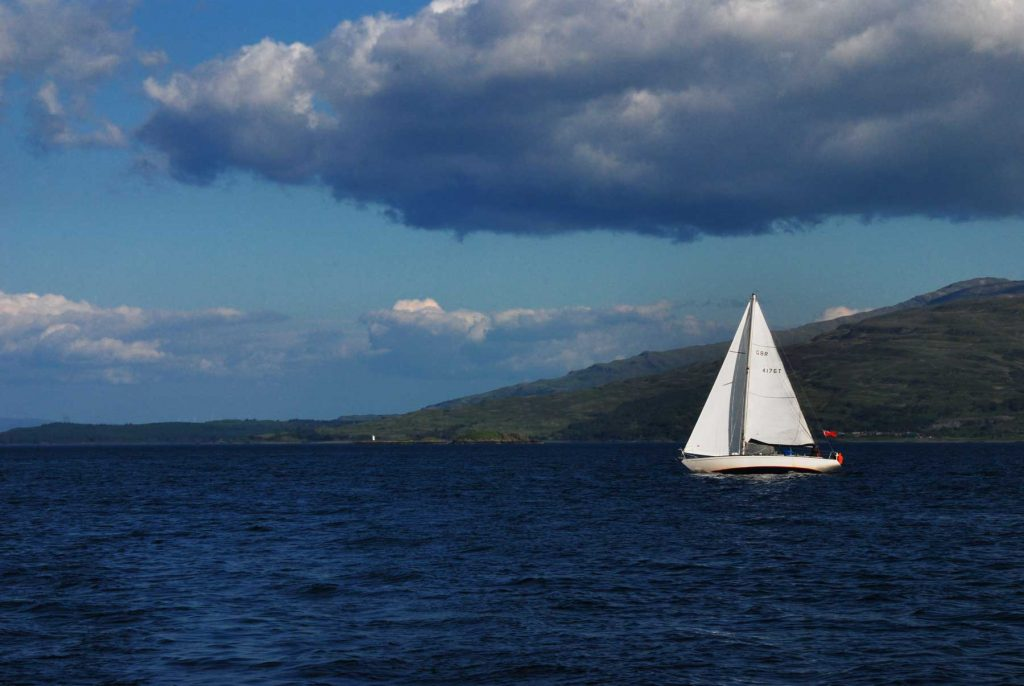 a lone yacht in the Sound of Mull