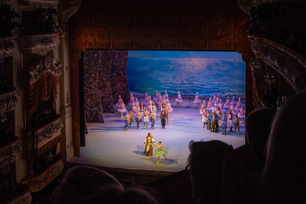 "The finale of the ballet ""Corsaire"", the stage bathed in purple light"