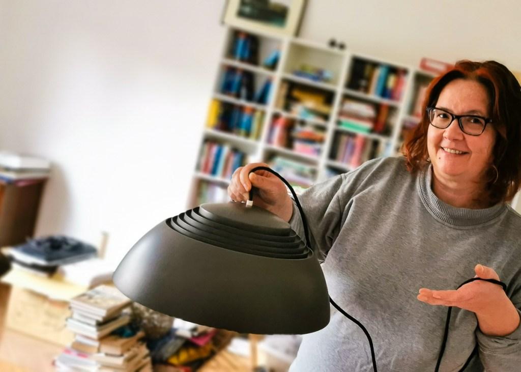 Anja holding a vintage Royal Poulsen lamp