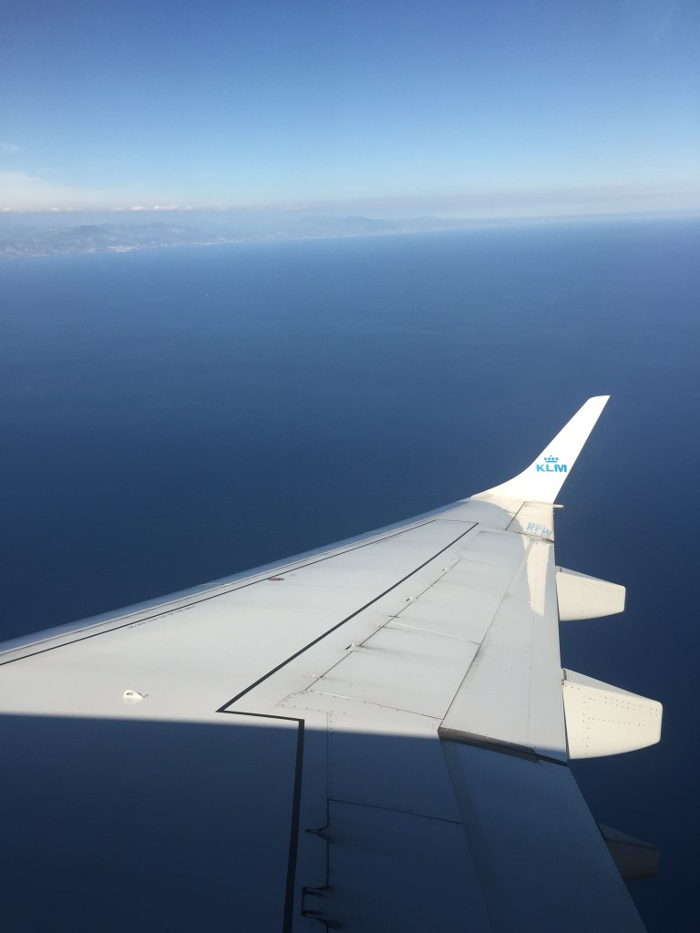 KLM plane wing out window over the french riviera.