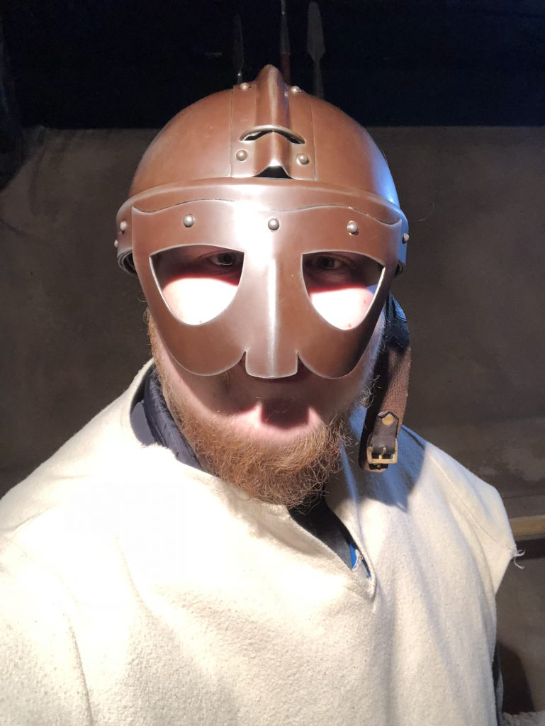 Embracing my Viking Roots wearing a viking helmet and tunic