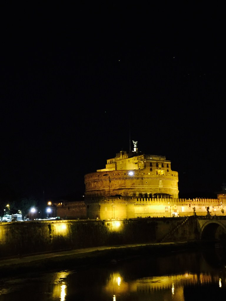 Castel Sant'Angelo seen at night from the Passetto di Borgo wall.