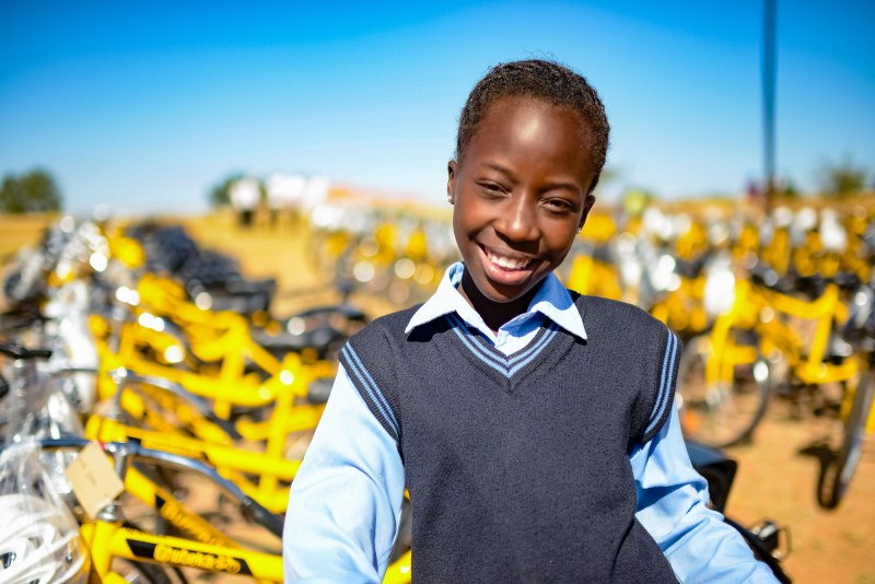 IMAGE DISTRIBUTED FOR WORLD BICYCLE RELIEF - Announced at the World Economic Forum-Africa (WEF-Africa) - Mosibudi, a 12-year old student from Tsekere Primary School, received a bicycle in Limpopo, South Africa on June 4th, 2015 through World Bicycle Relief, funded by UBS. Before receiving her bicycle, Mosibudi walked 90 minutes to and from school. She hopes to be a social worker one day and help protect neglected children. Thursday's school bicycle distribution ceremony provided bicycles to 300 students to help them overcome the barriers of distance enabling them to get to school faster and ready to learn. This is part of a larger program funded by UBS in South Africa that will culminate in a total of 2500 students receiving bicycles as part of World Bicycle Relief's Bicycles for Educational Empowerment Program (BEEP). For more information, please visit: www.worldbicyclerelief.org/ Follow us @PowerOfBicycles and Like us at facebook.com/worldbicyclerelief This image was released on Friday June 5, 2015.