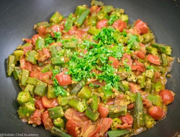 chopped coriander (cilantro) added to bhindi masala