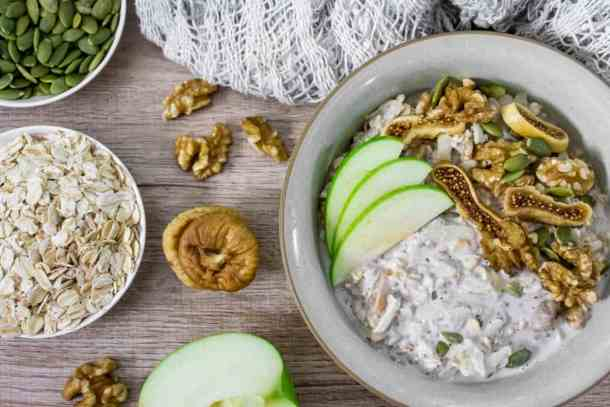 bircher-muesli-with-apple-figs-walnuts-and-pumpkin-seeds-in-a-bowl