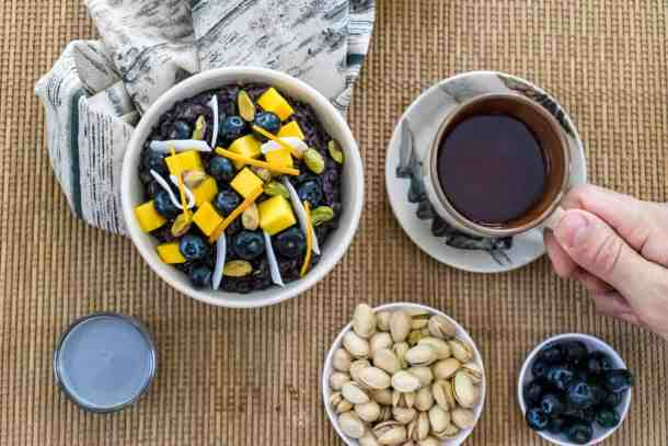 black-rice-pudding-with-mango-ready-to-eat-served-with-a-cup-of-tea