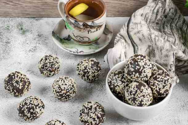chocolate-sesame-bliss-balls-served-with-a-cup-of-tea