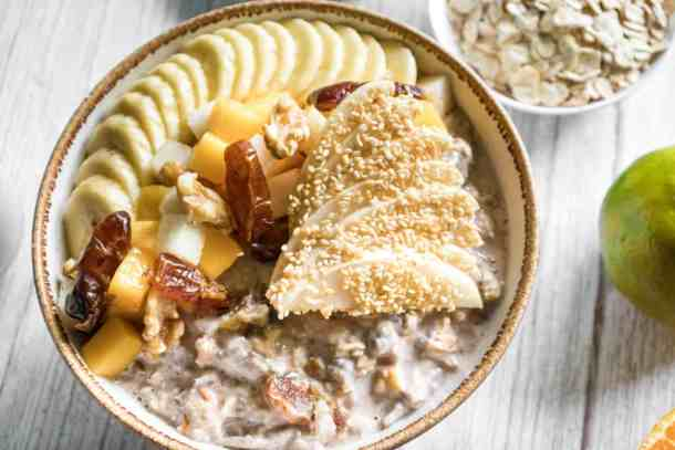 beautiful-bowl-of-healthy-breakfast-oats-with-sesame-milk-and-fresh-fruits
