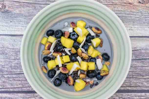 black-rice-pudding-with-mango-blueberries-and-pistachio-served-in-a-bowl