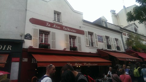 shop and cafe fronts with colourful awnings, Paris