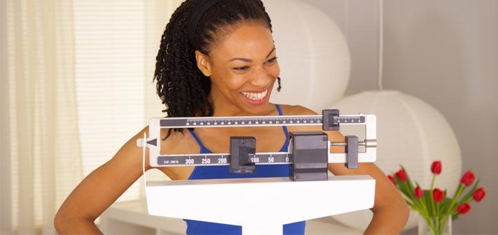 happy-black-woman-on-scale.jpg
