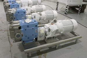 Waukesha Sanitary PD Pumps Mounted on Polished Stainless Steel Round Tube Frames
