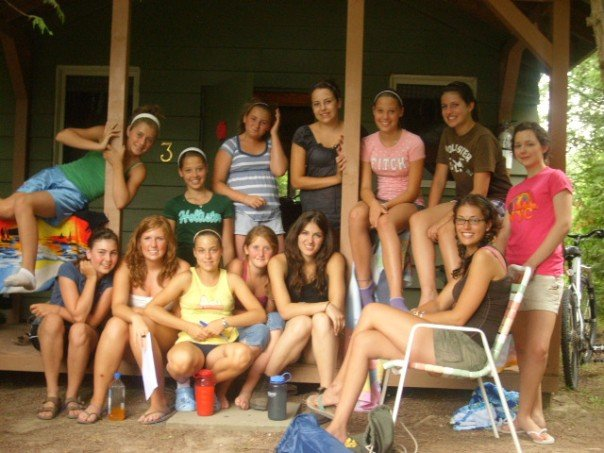 Group of girl campers sitting in front of cabin 3