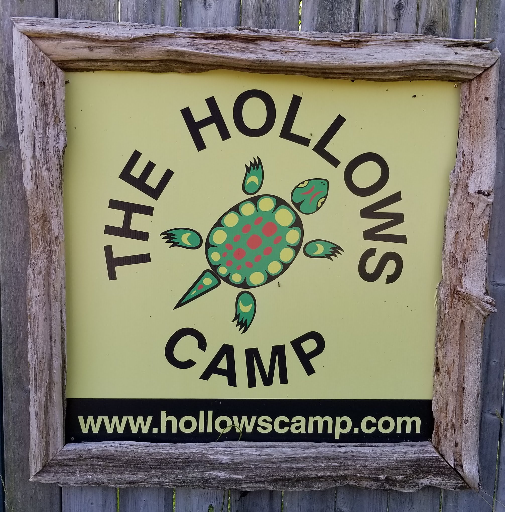 The Hollows Camp front entrance sign and logo