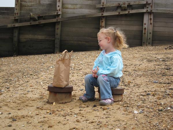 Flora admires her bag of shells