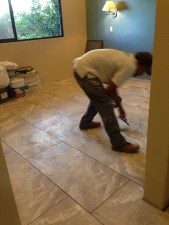 Richard artistically working on the tile