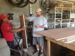 Scott & Federico measuring wood to cut!