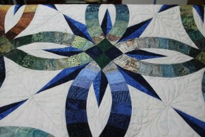 Love the star, 2 different blues are used, the long center star points are a Hoffman 1895 which reads more solid, the melon star points have a printed design that lightens the fabric just a little adding motion.