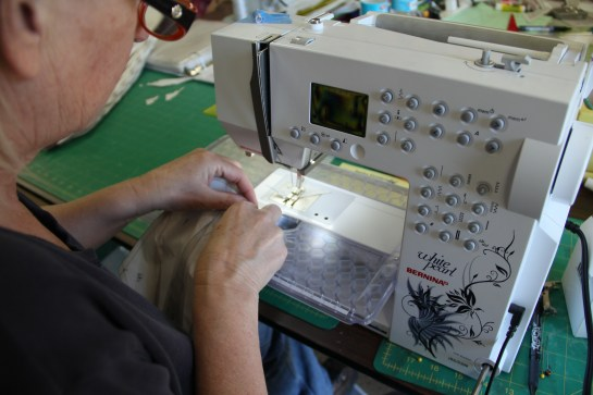 The master demos sewing tips and tricks