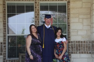 David's kiddos - Jason and Betty celebrating Jason graduating.  Along with Jason's daughter.