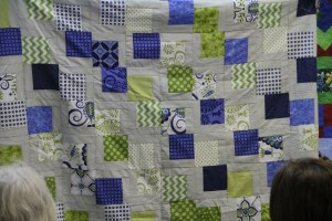 "A fun modern quilt - lots of ideas were tossed around for quilting on this one - I hope we get to see the final decision!  The ideas included an overall design or my favorite was to highlight the grey ""steps"" through the quilt to make the design stand out more!"