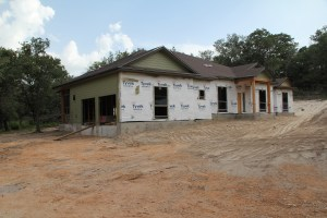 The view as you drive down the driveway.  Where you see the tyvek will be Austin Stone!  Travis said they will mix some of our sand in with their delivered sand to blend the house with the natural surroundings!