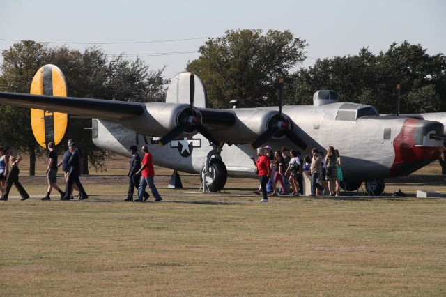 Families take the opportunity for photos with vintage planes
