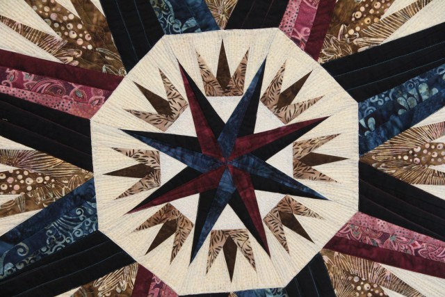 The compass rose starts the center of the quilt.