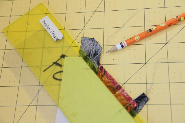 I use my add-a-quarter ruler and trim away the excess fabric.