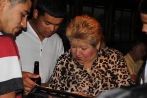Grandma and Paul looking through the graduates photo album