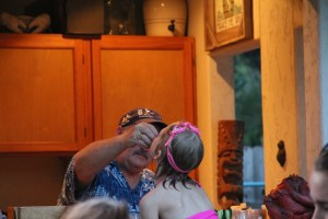 Grandpa feeds the little mermaid some grapes!