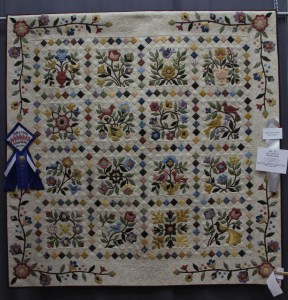 Susie's Quilt - she added the pieced sashings as well as the applique border.  The pattern had plain sashing and border.