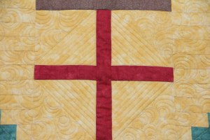 One of the 4 posts of the quilt