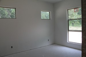Corner guest room, one bed will go under the high windows