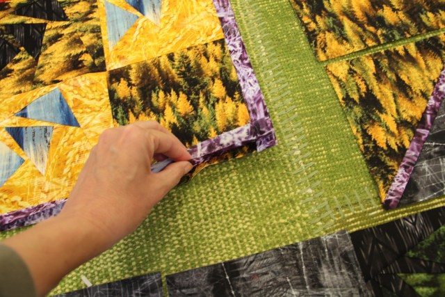Here I am getting ready to glue the last 2 sides to the quilt center