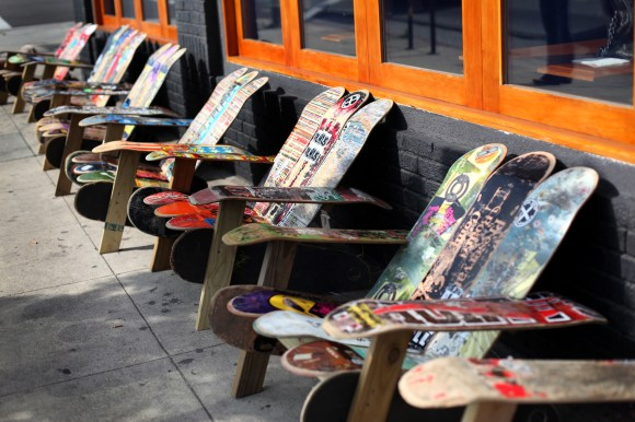 Chairs made of colorful skateboard decks outside of a restaurant in Los Angeles.