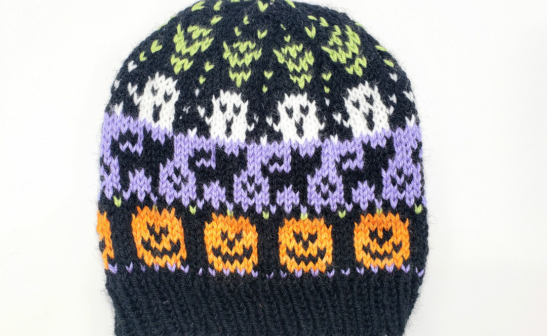 Free Halloween knitting pattern for stranded colorwork knit hat using Caron Simply Soft party yarn.