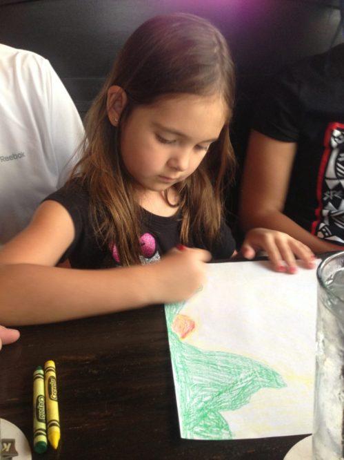 Holly Wilson-SWAIA 2013-Zoe drawing at dinner