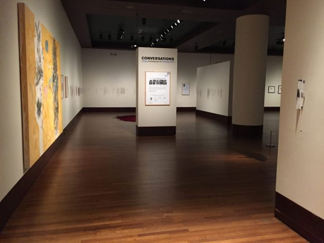 """This is the entrance into the show. Left: """"Conversations"""" by Mario Martinez. Back: """"Retracing the Trace"""" by Luzene Hill. At the Exhibition Conversations: Eiteljorg Museum 2015 Contemporary Art Fellowship."""