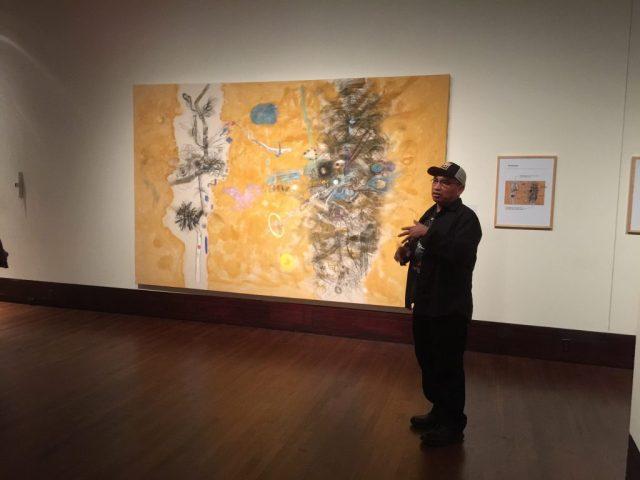 "Mario Martinez is explaining his piece ""Conversations"". At the Exhibition Conversations: Eiteljorg Museum 2015 Contemporary Art Fellowship."