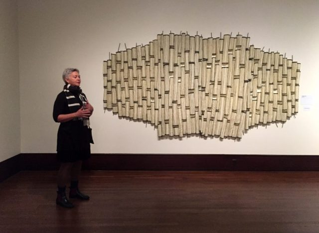 """Brenda Mallory is explaining her piece """"Interrupted Forms #2"""". At the Exhibition Conversations: Eiteljorg Museum 2015 Contemporary Art Fellowship."""
