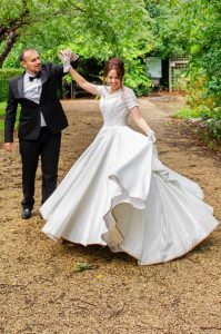 bride in couture wedding dress by Holly Winter Couture