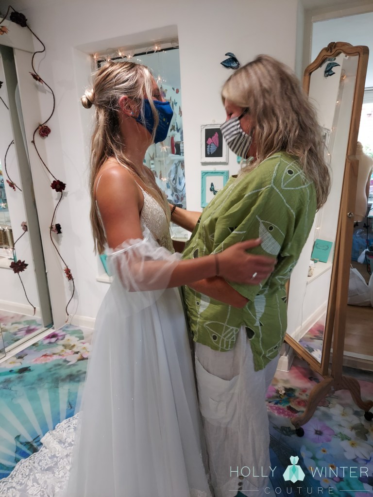 Real bride and mother of the bride at final bespoke wedding dress fitting at Holly Winter Couture
