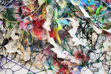 """""""Hidden Inheritance,"""" (Mid-view) Paper, plastic bags, string, tulle, garland, 7'H x 10'L x 3″D, 2014"""