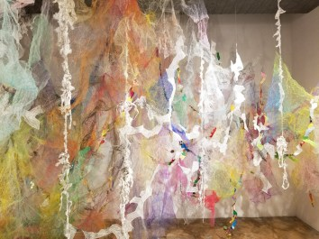 """""""Mind/Forest II"""" (Right Side) 2018, Polyester tulle, thread, duralene plastic, plastic rope, cotton gauze, origami paper, and monofilament wire, 20'L x 15'D x 14'H."""