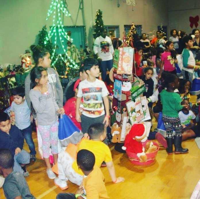 Holiday toy distribution at washington park community center