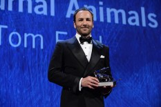 Director Tom Ford receives this year's Silver Lion for Best Film from the Grand Jury. (Photo courtesy of ASAC Images/Biennale Cinema))
